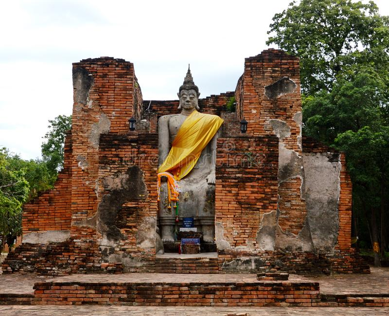 Buddha Stature in Ancient Temple. Wearing the gold symbol, standing tall in beauty stock photo