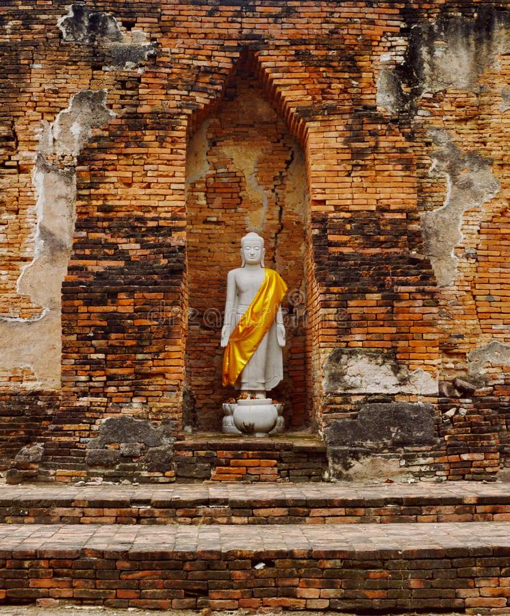 Buddha Stature in Ancient Temple. Buddha Stature in one of Thailand`s Ancient Temple, outside of Kanchanaburi royalty free stock photography