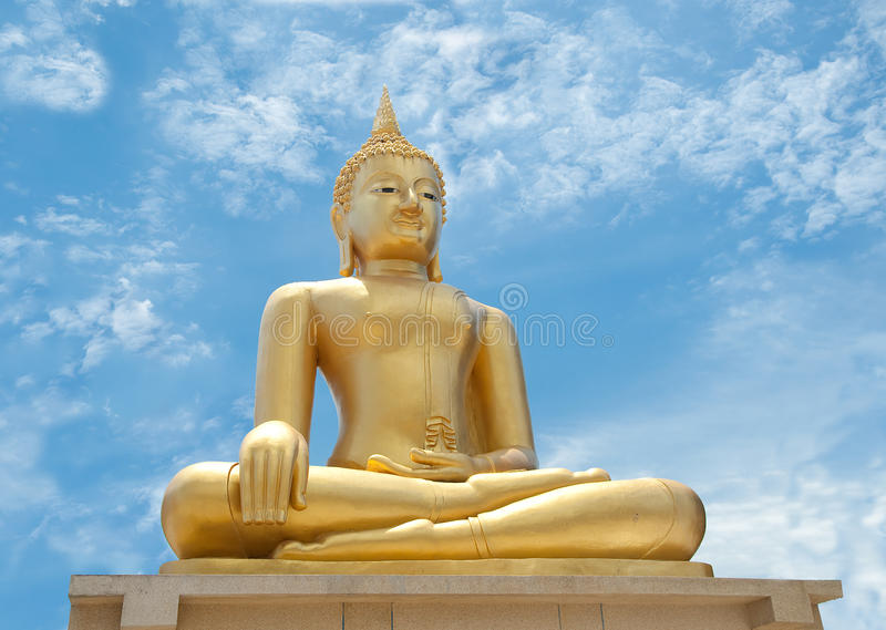 The Buddha status. On blue sky background royalty free stock image