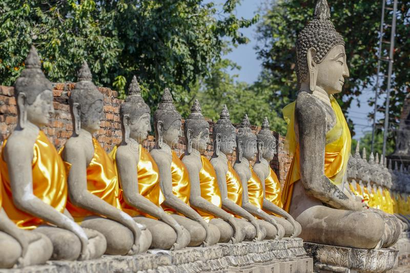 Buddha Status in Ancient old temple at  ayutthaya historical park area thailand. Background, statue, beautiful, head, green, art, face, antique, culture, asian stock photography