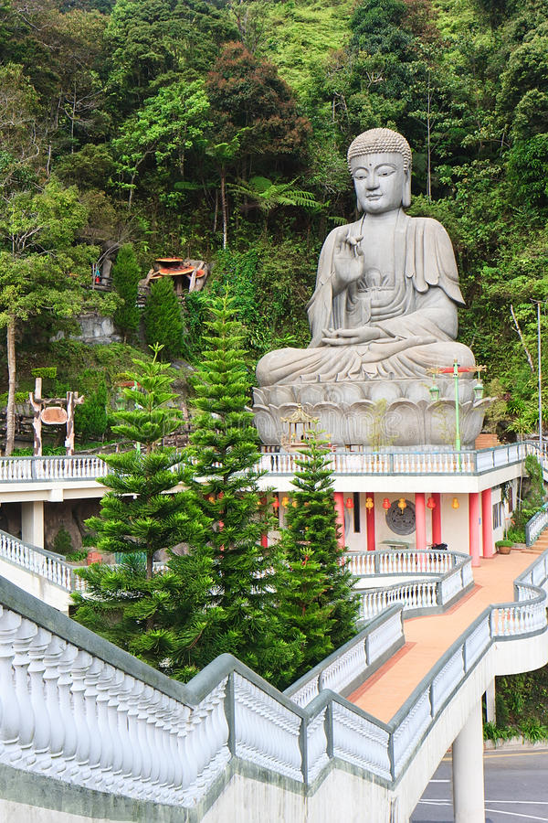 Buddha Status at Chin Swee Temple. Giant Buddha Status on a Lotus Flower at Genting Hightlands, Malaysia royalty free stock photos