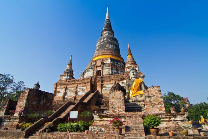 Buddha Status and the pagoda at wat yai chaimongkol temple royalty free stock images