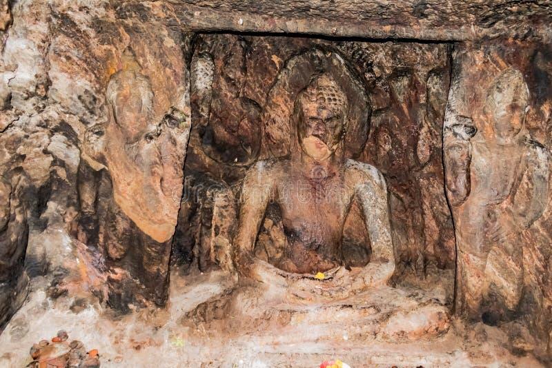 Budhha stone statue on wall in a buddhist place named as Bojjannakonda in sankaram village of visakhapatnam district of india, stock photos