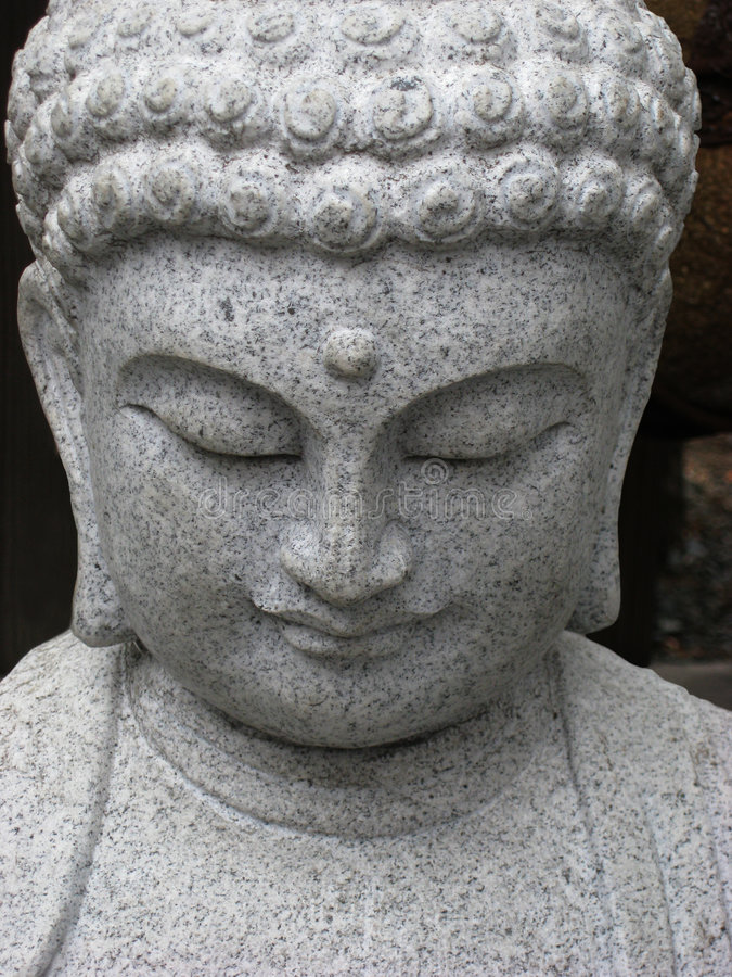 buddha vänder ner att se mot arkivfoton