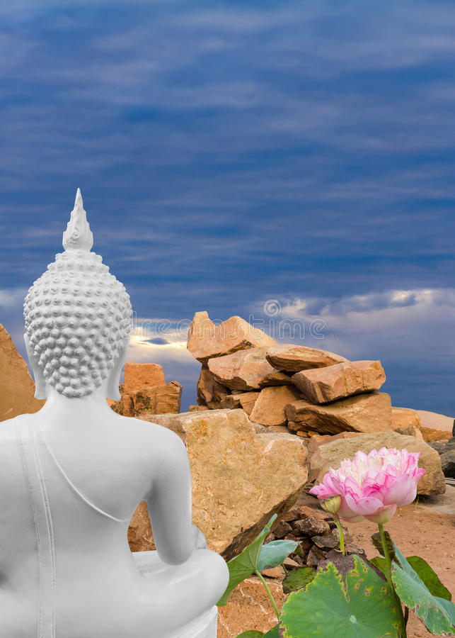 Buddha white with large stones. royalty free stock photo