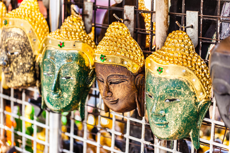 Buddha wooden masks stock photography