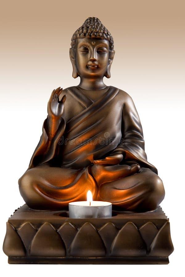 Buddhah candleholder arkivfoto