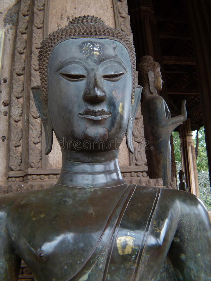 Buddhas in ancient temple in Vientiane stock photography