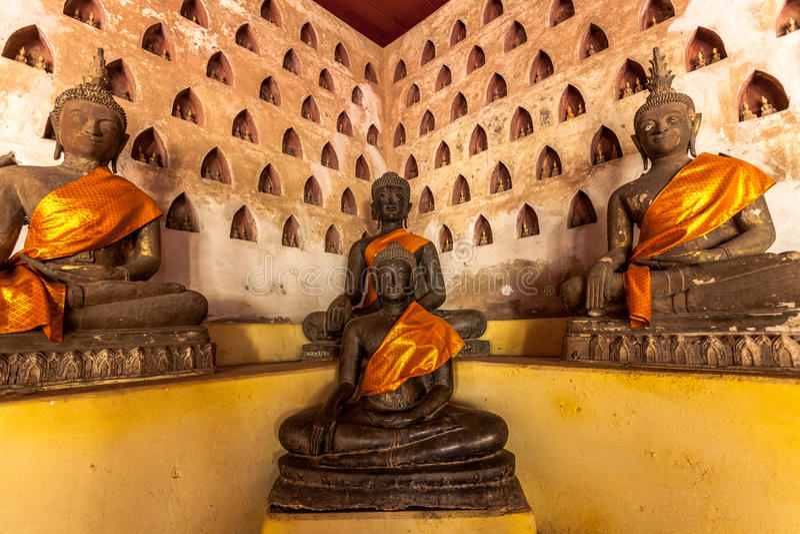 Buddhas in Wat Sisaket, Vientiane, Laos. Detail of statues of Buddha in Wat Sisaket temple, Vientiane, Laos royalty free stock image