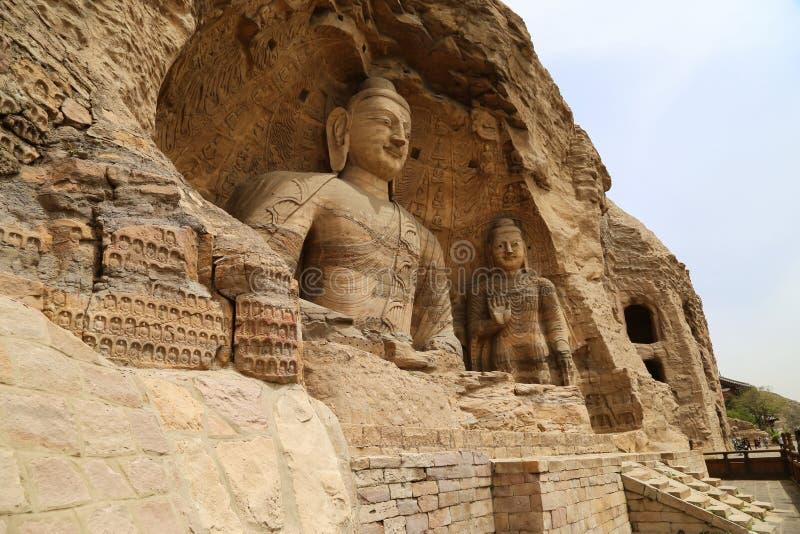 Buddhastaty, Yungang grottagrottor, Datong, Kina arkivfoto