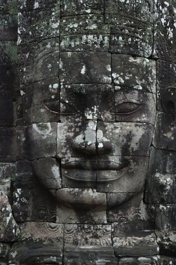 Buddhastenframsida på den Bayon templet arkivfoton