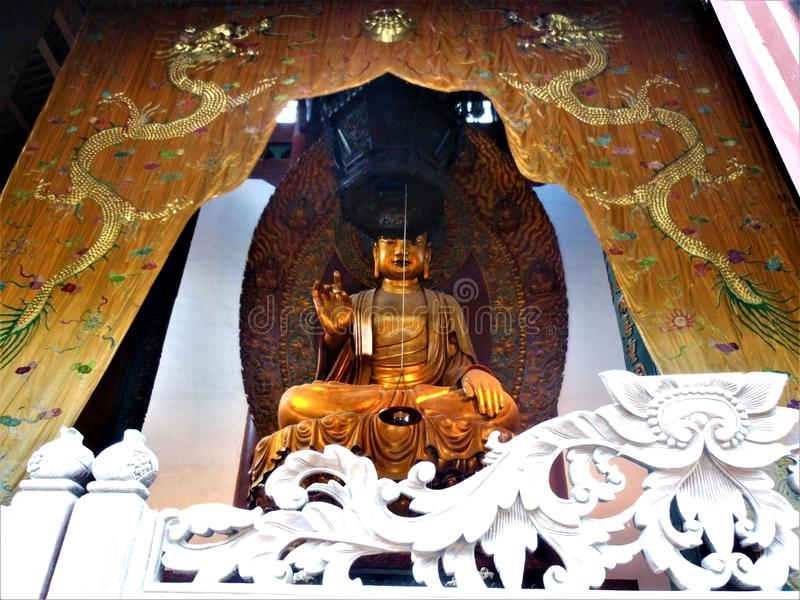 Buddhism, art and history. Buddhism, art, hiatory, Buddha statue, golden decoration and ornament, symbols and tradition, luxury and splendour, dragons and royalty free stock photography
