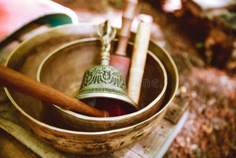 Buddhism ceremony. ethnic bell. Bowl for meditation. beater meditation. A Tibetan Singing Bowl. Ethnic things. bell. Bowl for meditation beater meditation royalty free stock photos