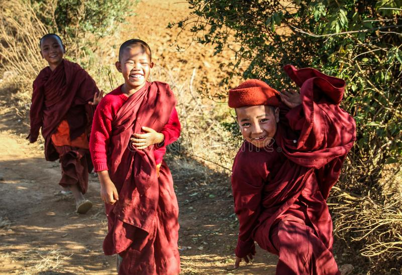 Young bhuddist monks are happy playing, Shan State, Myanmar. Buddhism in Myanmar is practiced by 89% of the country`s population, and is predominantly of the royalty free stock photography