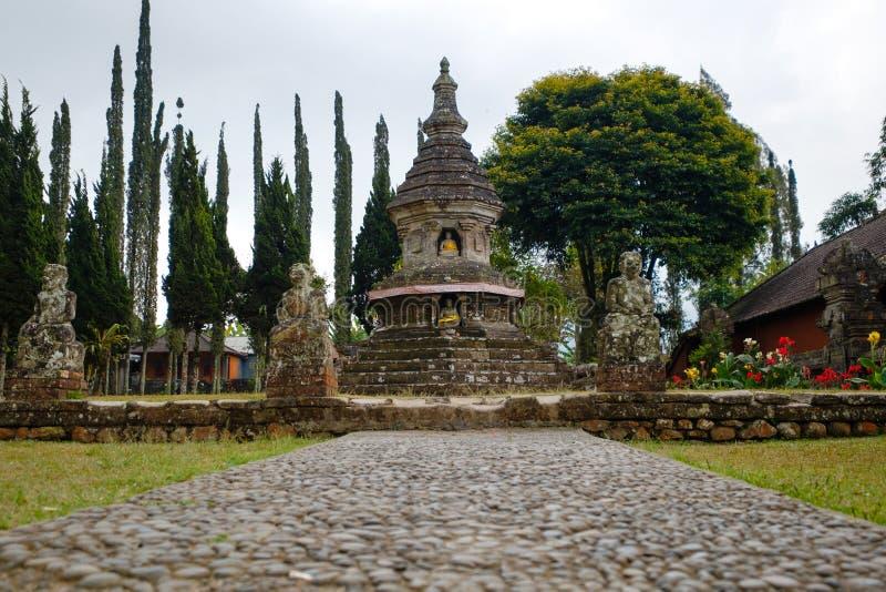 Buddhism stupa at Ulun Danu Beratan Temple. Buddhism stupa with Buddha statue at Ulun Danu Beratan Temple area - Bali, Indonesia stock photography