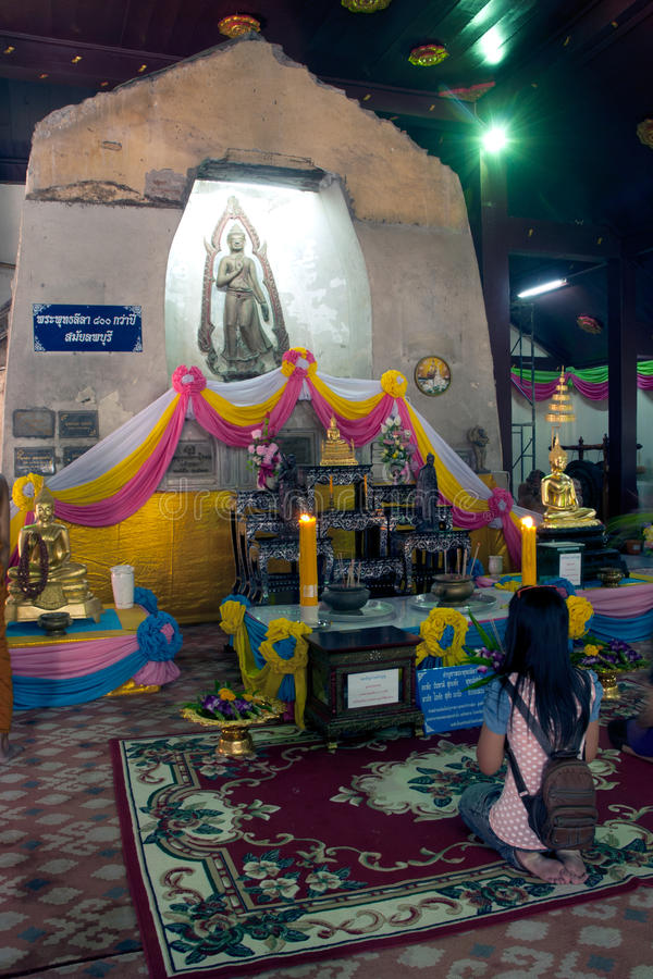 Buddhism Thai people worship on Buddha in Wat Naprameru temple. Ayutthaya,Thailand-February 10,2010 : Thai Buddhist people is worship of Phra Put Tha Lela stock photos