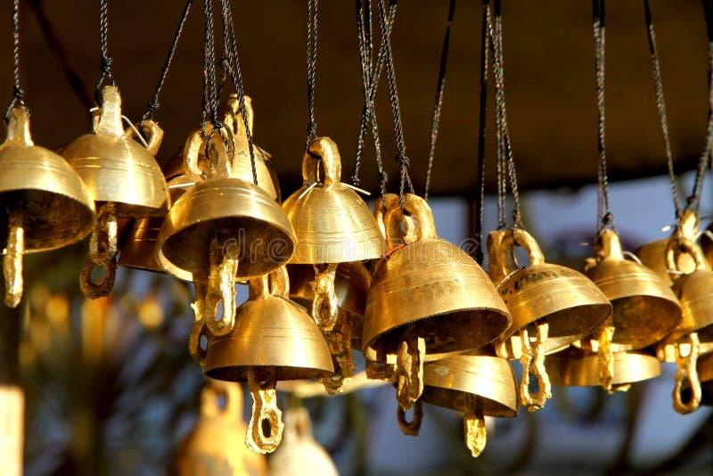 Buddhist bells. Golden bells in a buddhist temple stock photo