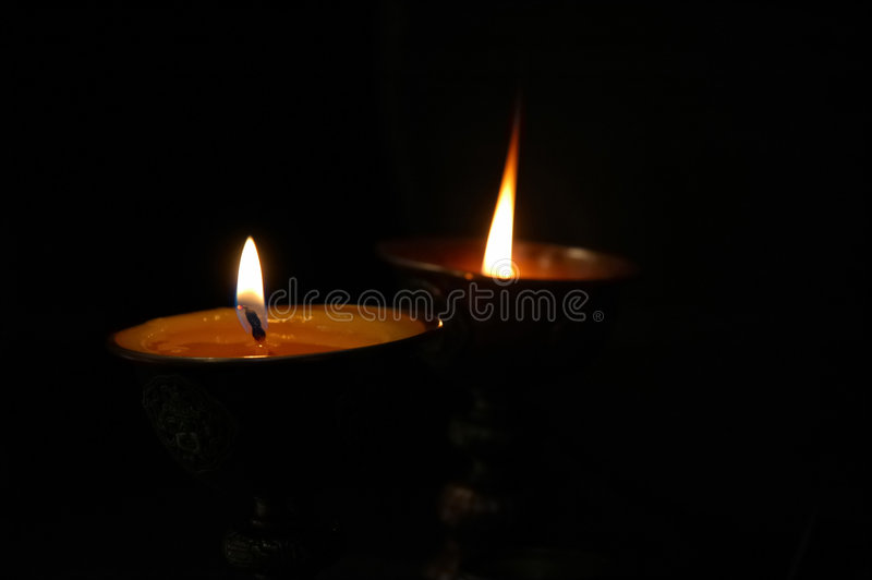 Buddhist butter lamps stock photo