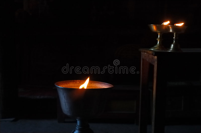 Buddhist butter lamps stock images
