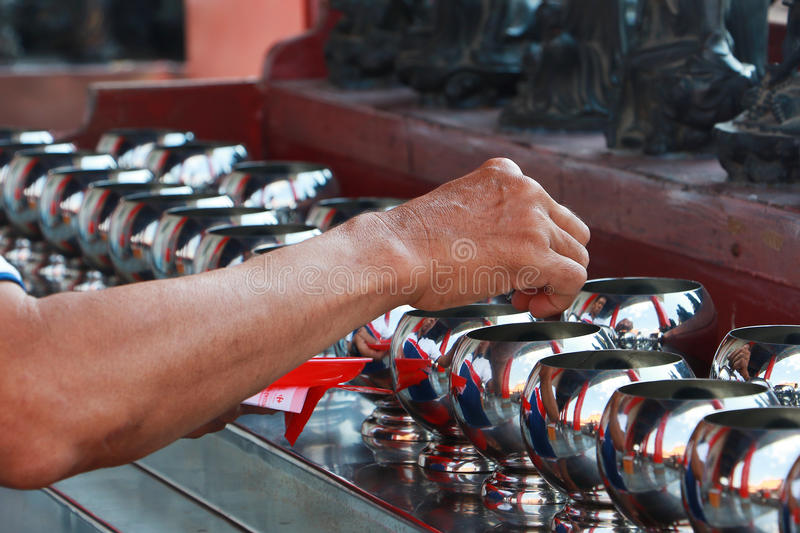 Buddhist is donating money to a Chinese temple by their faith and to maintain the temple. NONTHABURI - DECEMBER 30: Buddhists are donating money to a Chinese stock photos