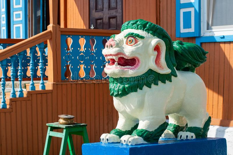 Buddhist figure of a snow lion in Ivolginsky datsan. royalty free stock photo