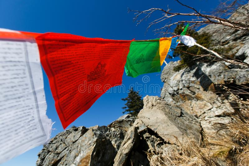 Buddhist flags with prayers and mantras develop on top of the mountain.  stock photos