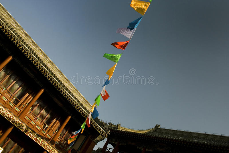 Buddhist flags in temple courtyard stock photography