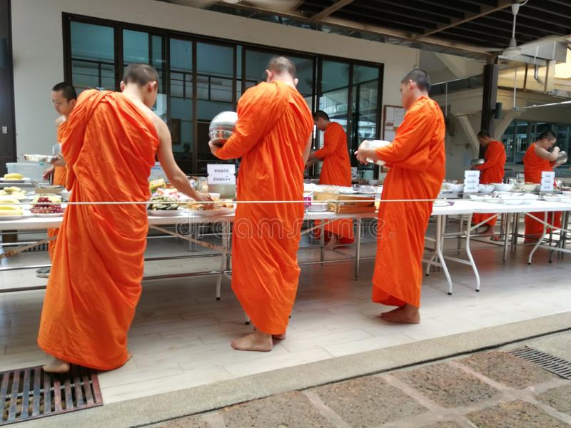 Buddhist Give The Offering Dedicated Essentials And Food To The