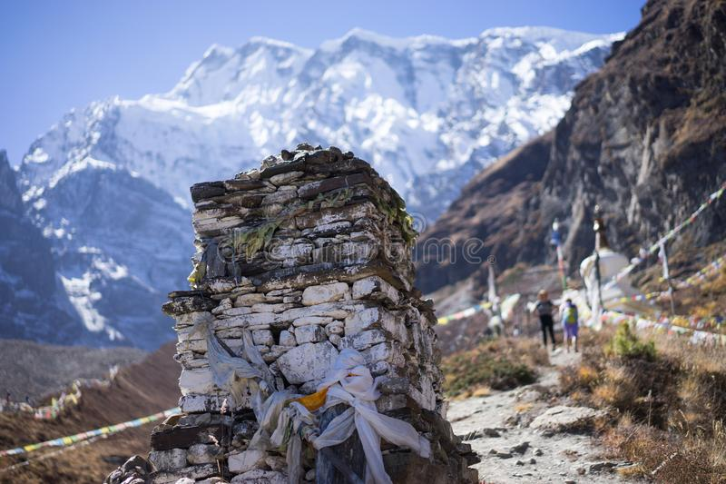 Buddhist gompa and prayer flags in the Himalaya range, Annapurna region, Nepal stock photo
