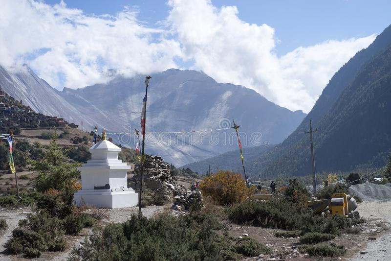 Buddhist gompa and prayer flags in the Himalaya range, Annapurna region, Nepal royalty free stock photos
