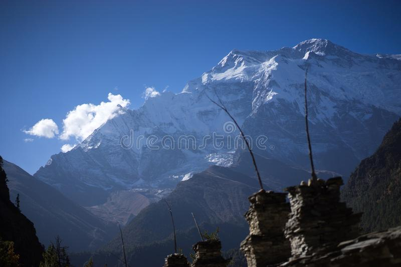 Buddhist gompa and prayer flags in the Himalaya range, Annapurna region, Nepal royalty free stock photo