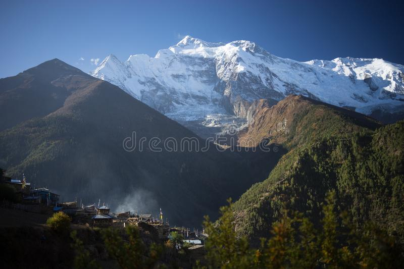 Buddhist gompa and prayer flags in the Himalaya range, Annapurna region, Nepal stock images