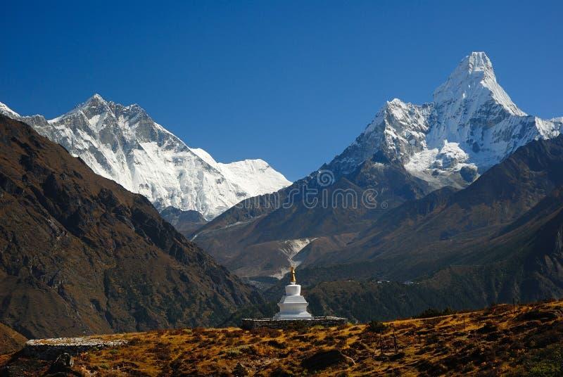 Buddhist Khumjung Stupa, Lhotse Peak and Ama Dablam Peak in Nepal royalty free stock photos