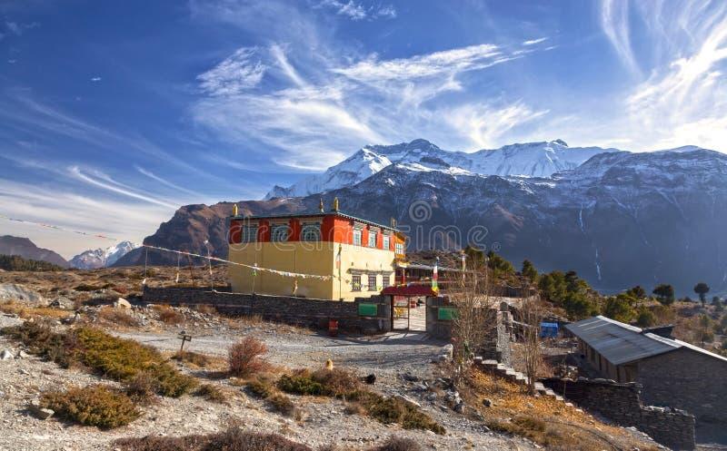 Buddhist Monastery Snowcapped Annapurna Mountain Range Landscape Nepal Himalaya. Lophelling Buddhist Monastery Exterior and Distant Snowcapped Annapurna Range stock image