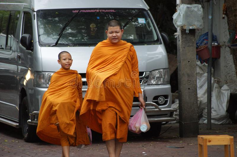 Buddhist monks alms on Bangkok`s streets stock image
