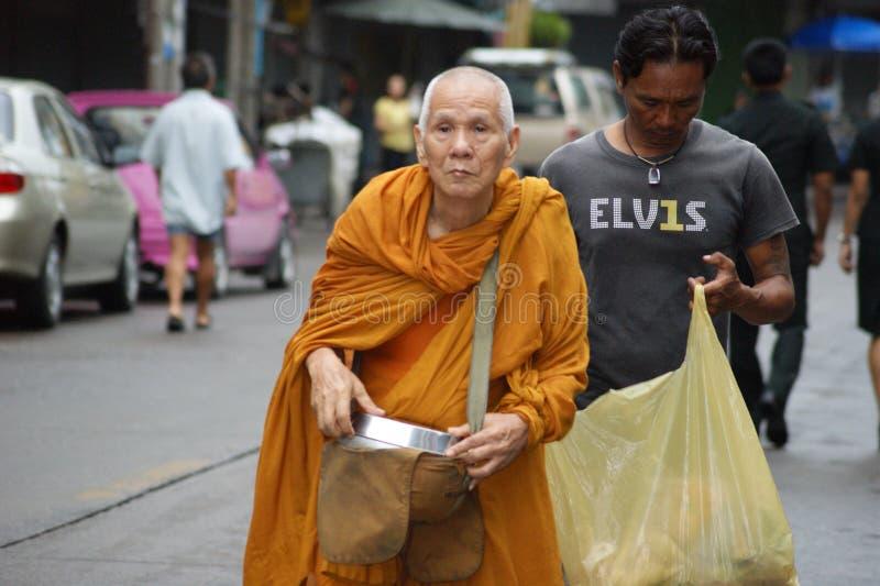 Buddhist monks alms on Bangkok`s streets stock photos