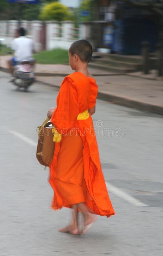 Buddhist monk at the morning procession, Luang Prabang, Laos stock photography