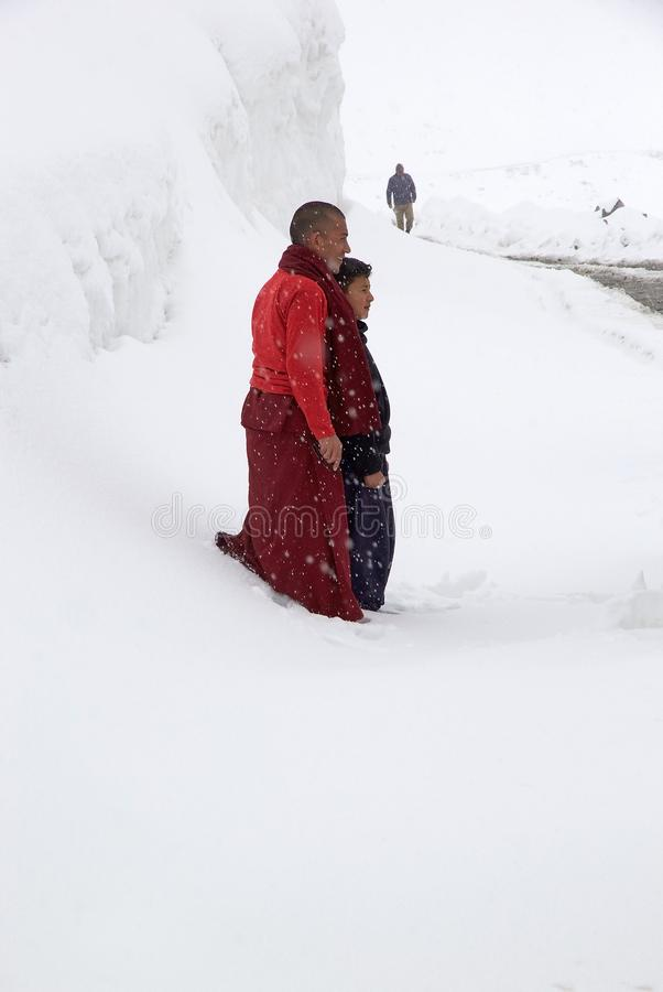 Buddhist monk and people at the Khardung La Pass, Ladakh, India royalty free stock photography