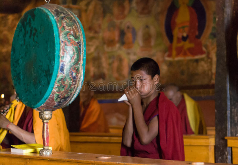 Buddhist monk playing on shell royalty free stock photo