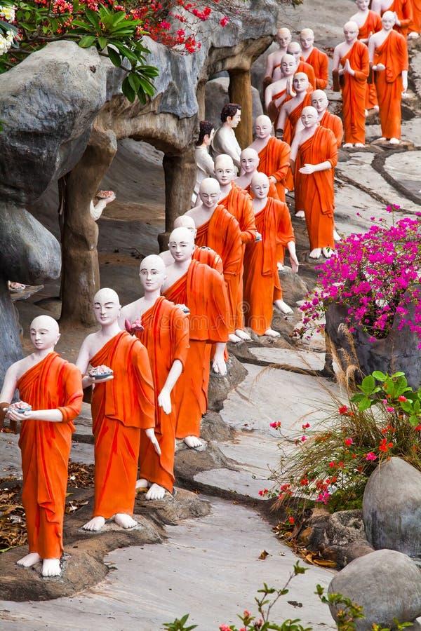 Buddhist monk statues going to Gold Buddha temple, Dambulla, Sri Lanka stock image