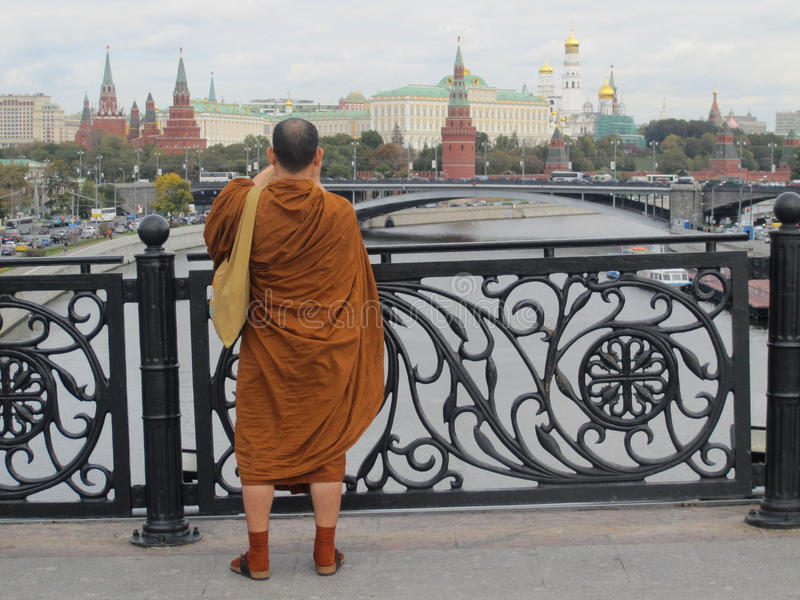 Buddhist monk travelling in Russia stock photography