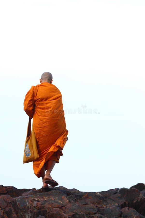Buddhist monk. A buddhist monk is walking royalty free stock image