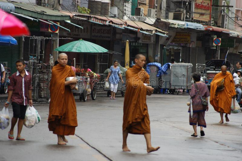 Buddhist monks alms on Bangkok`s streets stock photos