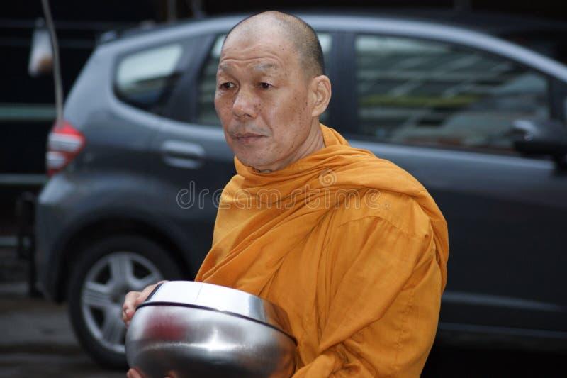 Buddhist monks alms on Bangkok`s streets stock photo