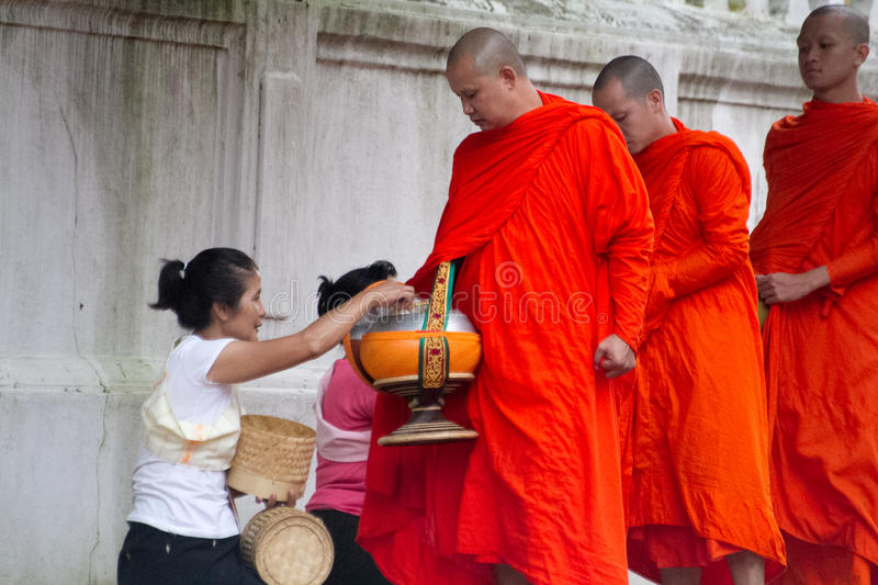 Buddhist monks collecting alms in the morning. royalty free stock photography