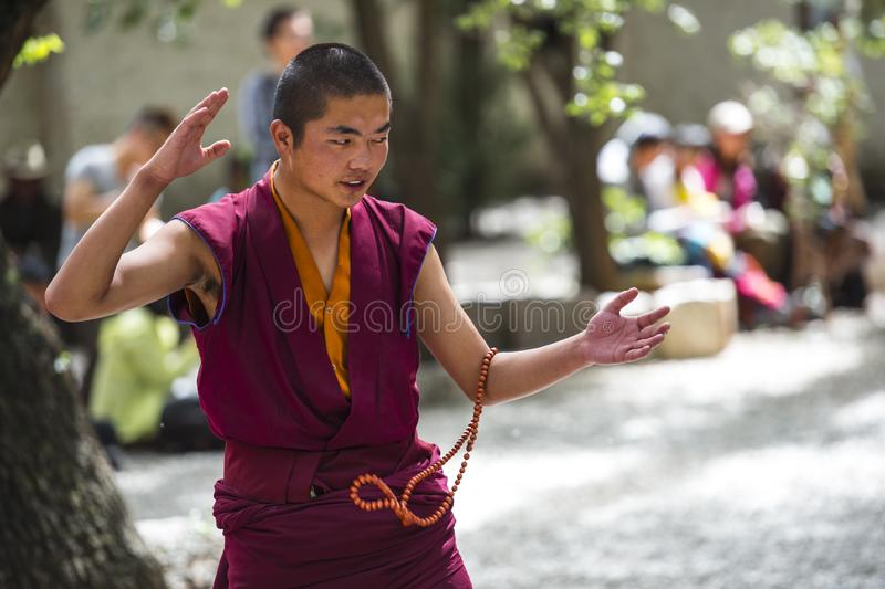 Buddhist monks` debating practice ,this monk is clapping when he asking , Sera monastery , Lhasa , Tibet. Monks of Sera monastery practice the debate royalty free stock images