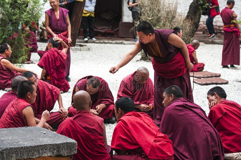 Buddhist monks` debating practice , drastic debating , Sera monastery , Tibet. Monks of Sera monastery practice the debate everyday . monks would debate the royalty free stock photo