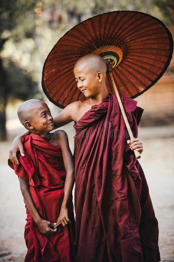 Buddhist monks. Friends.Smiling kids. Buddhist monks smiling as seen in Bagan, Myanmar royalty free stock photo