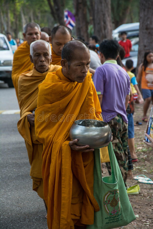 Buddhist monks are given food offering from people for Songkran day or Thai New Year Fe. Prachuap Khiri Khan, THAILAND - APRIL 13 : Buddhist monks are given food stock images