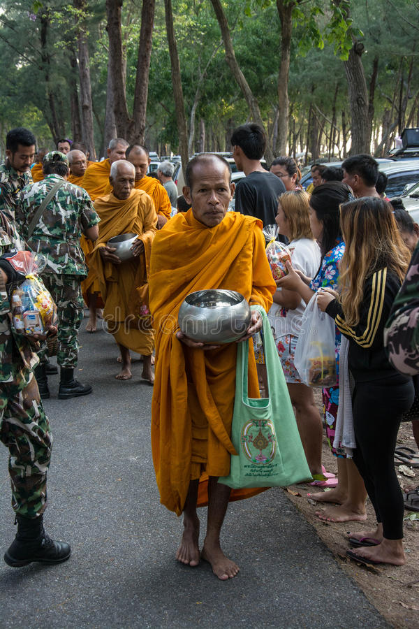 Buddhist monks are given food offering from people for Songkran day or Thai New Year Fe. Prachuap Khiri Khan, THAILAND - APRIL 13 : Buddhist monks are given food stock photo